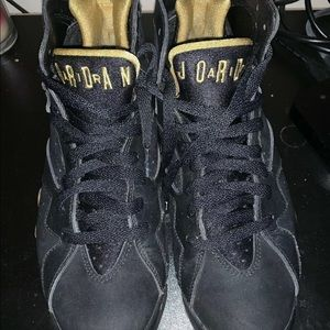 Air Jordan 7 Retro black golden moment